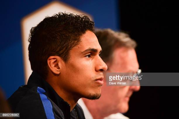 Raphael Varane of France and Press attache Philippe Tournon during the France press conference at Stade de France on June 12 2017 in Paris France
