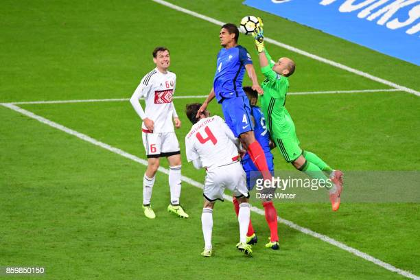 Raphael Varane of France challenges goalkeeper Syarhey Chernik of Belarus during the Fifa 2018 World Cup qualifying match between France and Belarus...
