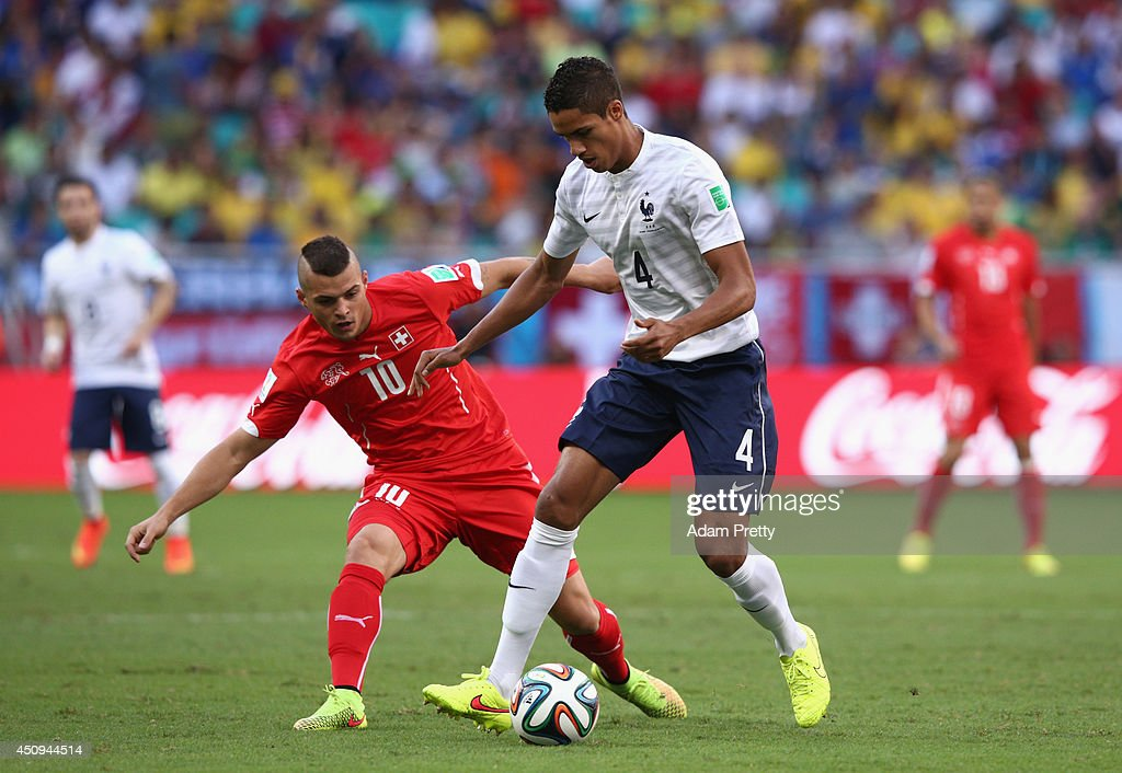 Raphael Varane of France controls the ball against Granit Xhaka of Switzerland during the 2014 FIFA World Cup Brazil Group E match between Switzerland and France at Arena Fonte Nova on June 20, 2014 in Salvador, Brazil.