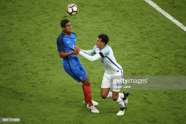 Raphael Varane of France in action with Dele Alli of England during the International Friendly match between France and England at Stade de France on...
