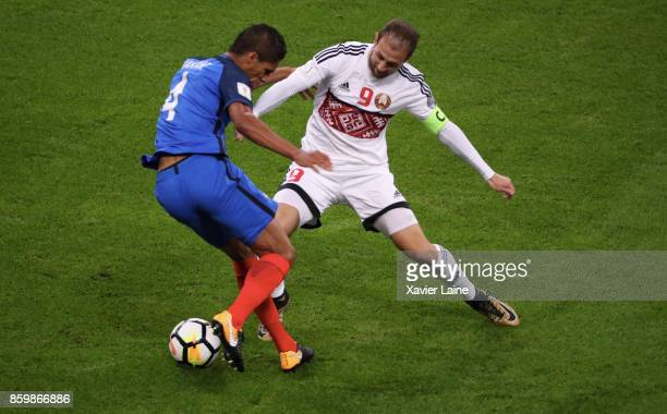 Raphael Varane of France in action with Igor Stasevich of Belarus during the FIFA 2018 World Cup Qualifier between France and Netherlands at Stade de...