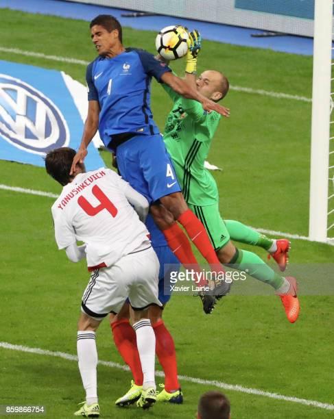 Raphael Varane of France jump over Sergei Chernik of Belarus during the FIFA 2018 World Cup Qualifier between France and Netherlands at Stade de...