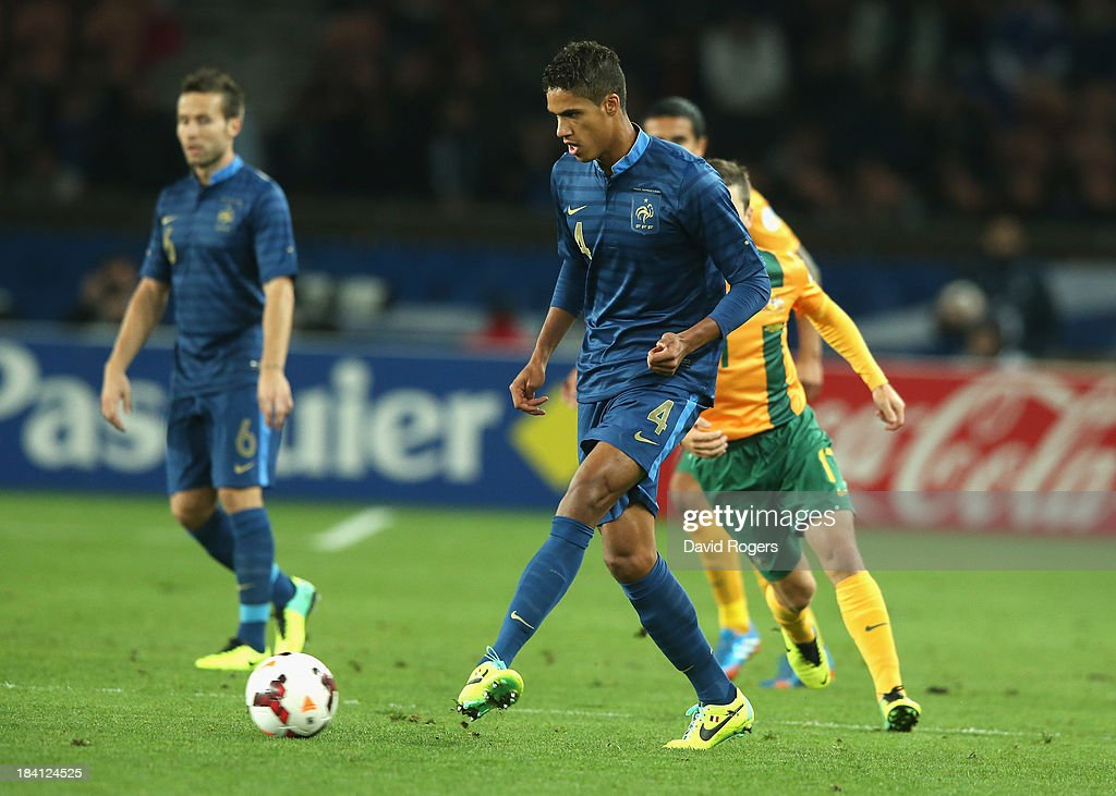 <a gi-track='captionPersonalityLinkClicked' href=/galleries/search?phrase=Raphael+Varane&family=editorial&specificpeople=7365948 ng-click='$event.stopPropagation()'>Raphael Varane</a> of France passes the ball during the International Friendly match between France and Australia at Parc des Princes on October 11, 2013 in Paris, France.