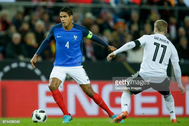 Raphael Varane of France Timo Werner of Germany during the International Friendly match between Germany v France at the RheinEnergie Stadium on...