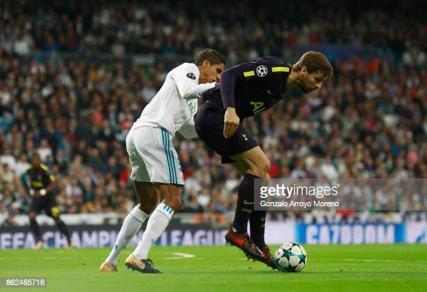 Raphael Varane of Real Madrid and Fernando Llorente of Tottenham Hotspur battle for possession during the UEFA Champions League group H match between...
