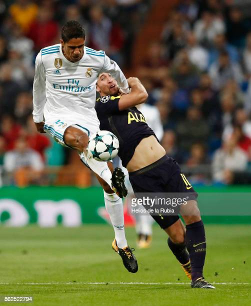 Raphael Varane of Real Madrid and Harry Kane of Totteham Hotspur compete for the ball during the UEFA Champions League group H match between Real...