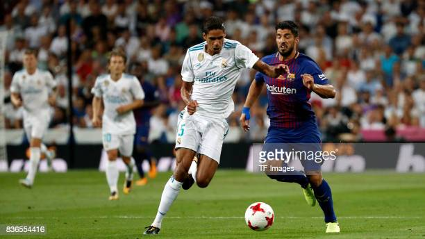 Raphael Varane of Real Madrid and Lucis Suarez of Barcelona battle for the ball during the Supercopa de Espana Supercopa Final 2nd Leg match between...