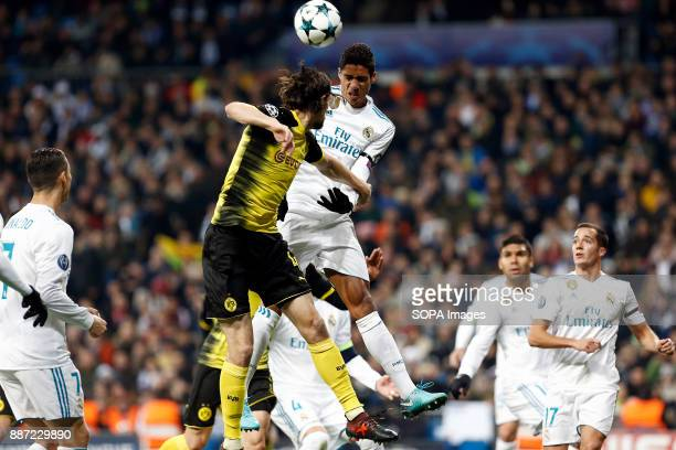 Raphael Varane of Real Madrid and Subotic of Borussia Dortmund all battle to win a header during the UEFA Champions League group H match between Real...