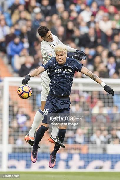 Raphael Varane of Real Madrid battles for the ball with Adalberto Penaranda of Malaga CF during their La Liga 201617 match between Real Madrid and...