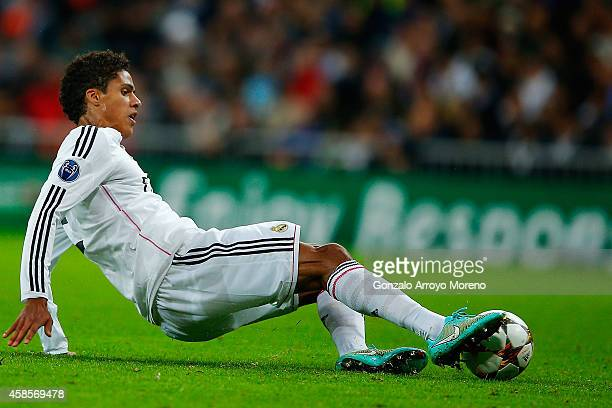 Raphael Varane of Real Madrid CF saves the ball during the UEFA Champions League Group B match between Real Madrid CF and Liverpool FC at Estadio...