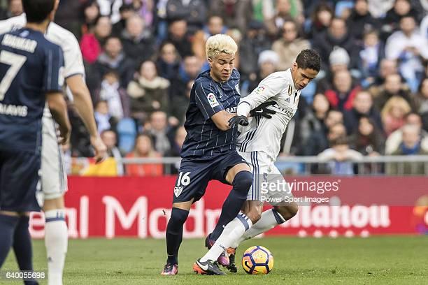 Raphael Varane of Real Madrid competes for the ball with Adalberto Penaranda of Malaga CF during their La Liga 201617 match between Real Madrid and...