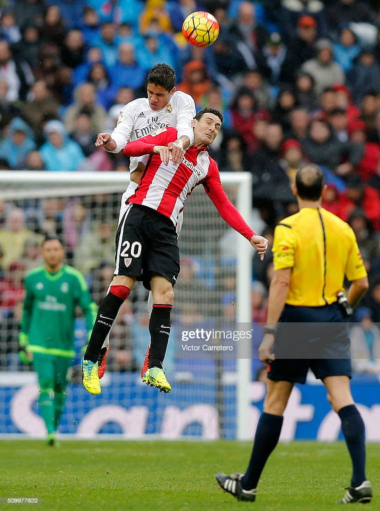 Raphael Varane (L) of Real Madrid competes for the ball with <a gi-track='captionPersonalityLinkClicked' href=/galleries/search?phrase=Aritz+Aduriz&family=editorial&specificpeople=822012 ng-click='$event.stopPropagation()'>Aritz Aduriz</a> of Athletic Club during the La Liga match between Real Madrid CF and Athletic Club at Estadio Santiago Bernabeu on February 13, 2016 in Madrid, Spain.