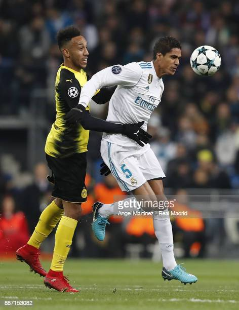 Raphael Varane of Real Madrid competes for the ball with PierreEmerick Aubameyang of Borussia Dortmund during the UEFA Champions League group H match...
