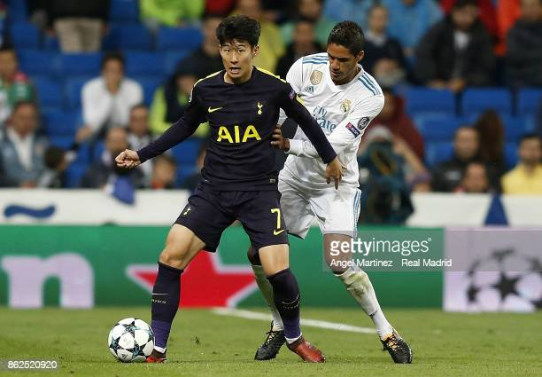 Raphael Varane of Real Madrid competes for the ball with HeungMin Son of Tottenham Hotspur during the UEFA Champions League group H match between...