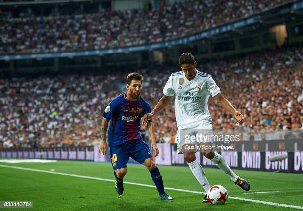 Raphael Varane of Real Madrid competes for the ball with Lionel Messi of Barcelona during the Supercopa de Espana Supercopa Final 2nd Leg match...