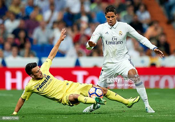 Raphael Varane of Real Madrid competes for the ball with Nicola Sansone of Villarreal during the La Liga match between Real Madrid CF and Villarreal...