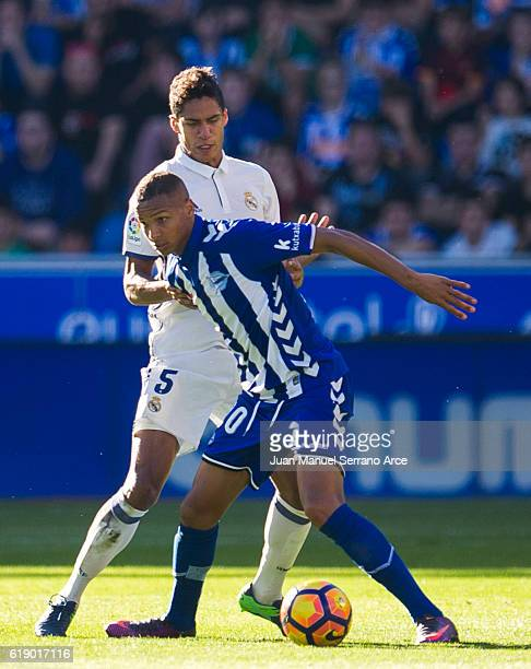 Raphael Varane of Real Madrid duels for the ball with Deyverson Brum of Deportivo Alaves during the La Liga match between Deportivo Alaves and Real...
