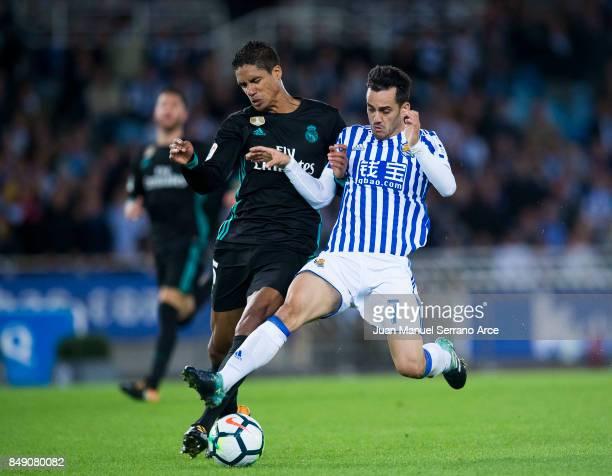 Raphael Varane of Real Madrid duels for the ball with Juan Miguel Jimenez 'Juanmi' of Real Sociedad during the La Liga match between Real Sociedad de...
