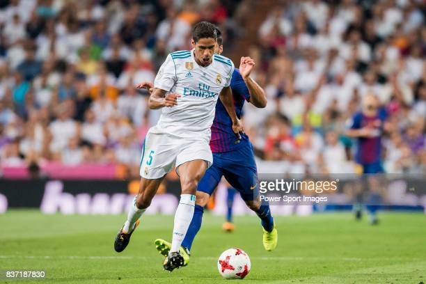 MADRID SPAIN AUGUST 16 Raphael Varane of Real Madrid fights for the ball with Luis Suarez of FC Barcelona during their Supercopa de Espana Final 2nd...