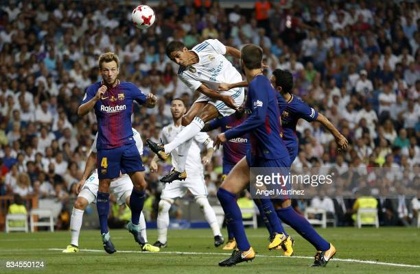Raphael Varane of Real Madrid heads the ball during the Supercopa de Espana Final second leg match between Real Madrid and FC Barcelona at Estadio...