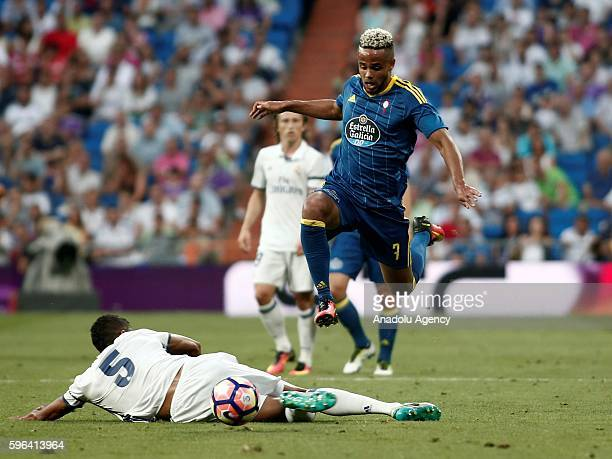 Raphael Varane of Real Madrid is in action against Theo Bongonda of Celta Vigo during the Spanish first league La Liga soccer match between Real...