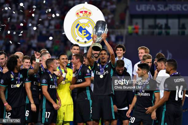 Raphael Varane of Real Madrid lifts the trophy as his team celebrate the win after the UEFA Super Cup match between Real Madrid and Manchester United...