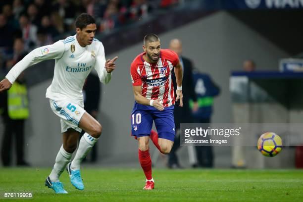 Raphael Varane of Real Madrid Yannick Carrasco of Atletico Madrid during the Spanish Primera Division match between Atletico Madrid v Real Madrid at...