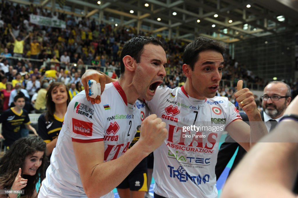 Raphael Vieira de Oliveira and Giacomo Sintiniof Itas Diatec Trentino Trentino celebrate victory after game 5 of Playoffs Finals between Itas Diatec Trentino and Copra Elior Piacenza at PalaTrento on May 12, 2013 in Trento, Italy.