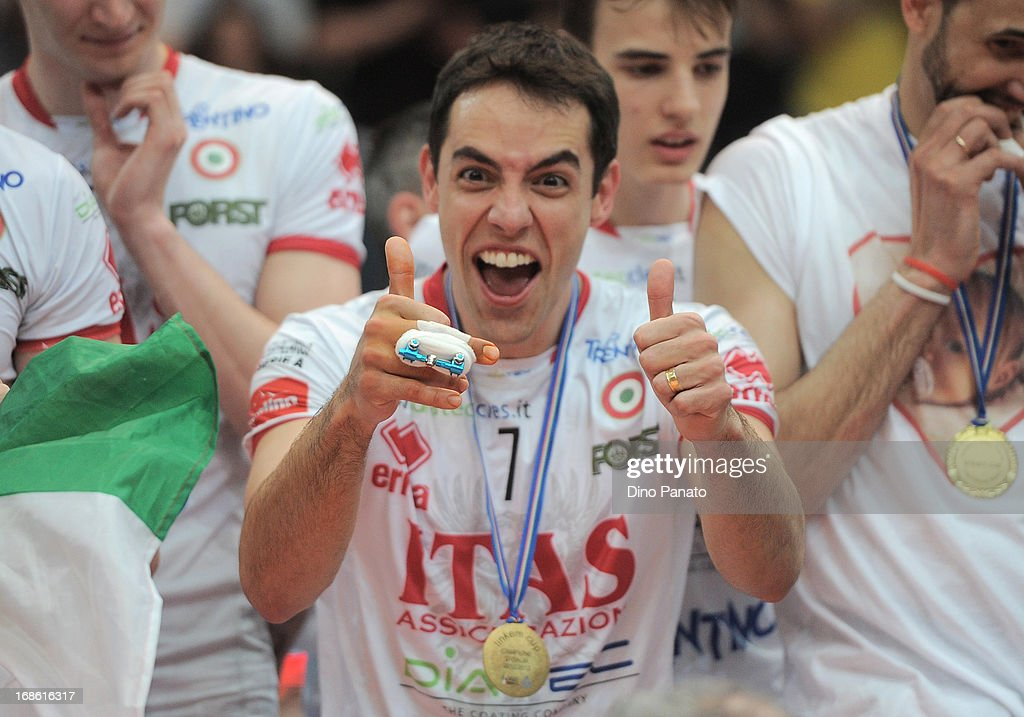 Raphael Vieira de Oliveira of Itas Diatec Trentino celebrate victory during the cup presentation ceremony after game 5 of Playoffs Finals between Itas Diatec Trentino and Copra Elior Piacenza at PalaTrento on May 12, 2013 in Trento, Italy.
