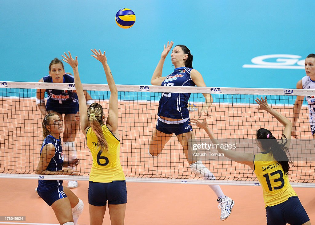 Raphaela Folie of Italy spikes the ball during day three of the FIVB World Grand Prix Sapporo 2013 match between Brazil and Italy at Hokkaido Prefectural Sports Center on August 30, 2013 in Sapporo, Hokkaido, Japan.