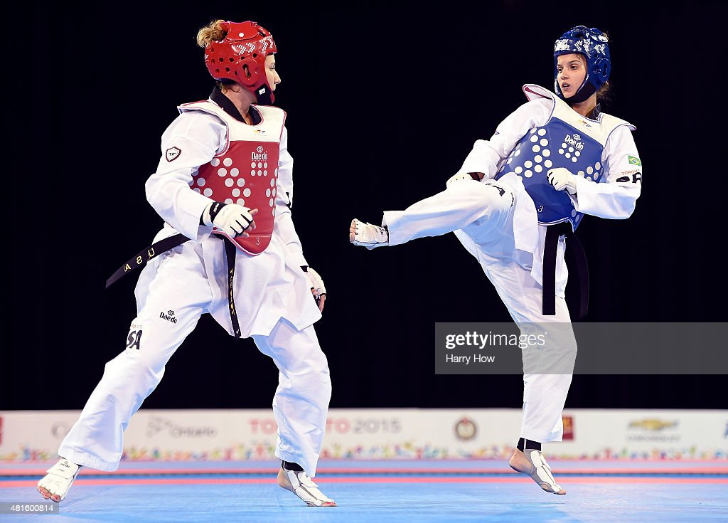Raphaella Galacho of Brazil competes against Jackie Galloway of the United States of America in the women's 67kg plus taekwando semifinal during the...