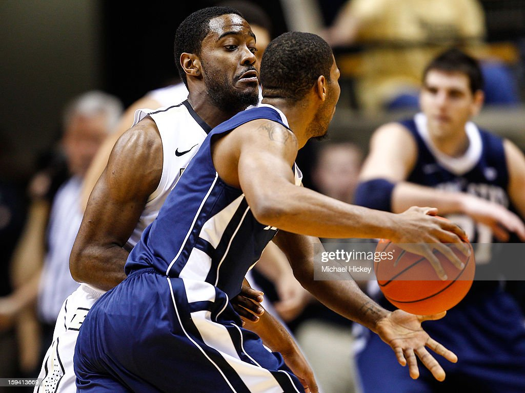 Rapheal Davis #35 of the Purdue Boilermakers applies tight defense as D.J. Newbill #2 of the Penn State Nittany Lions dribbles at Mackey Arena on January 13, 2013 in West Lafayette, Indiana. Purdue defeated Penn State 60-42.