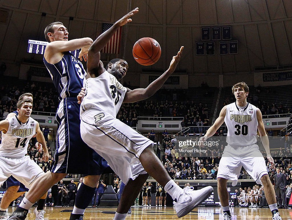 Rapheal Davis #35 of the Purdue Boilermakers battles for the ball in front of Patrick Ackerman #32 of the Penn State Nittany Lions at Mackey Arena on January 13, 2013 in West Lafayette, Indiana. Purdue defeated Penn State 60-42.
