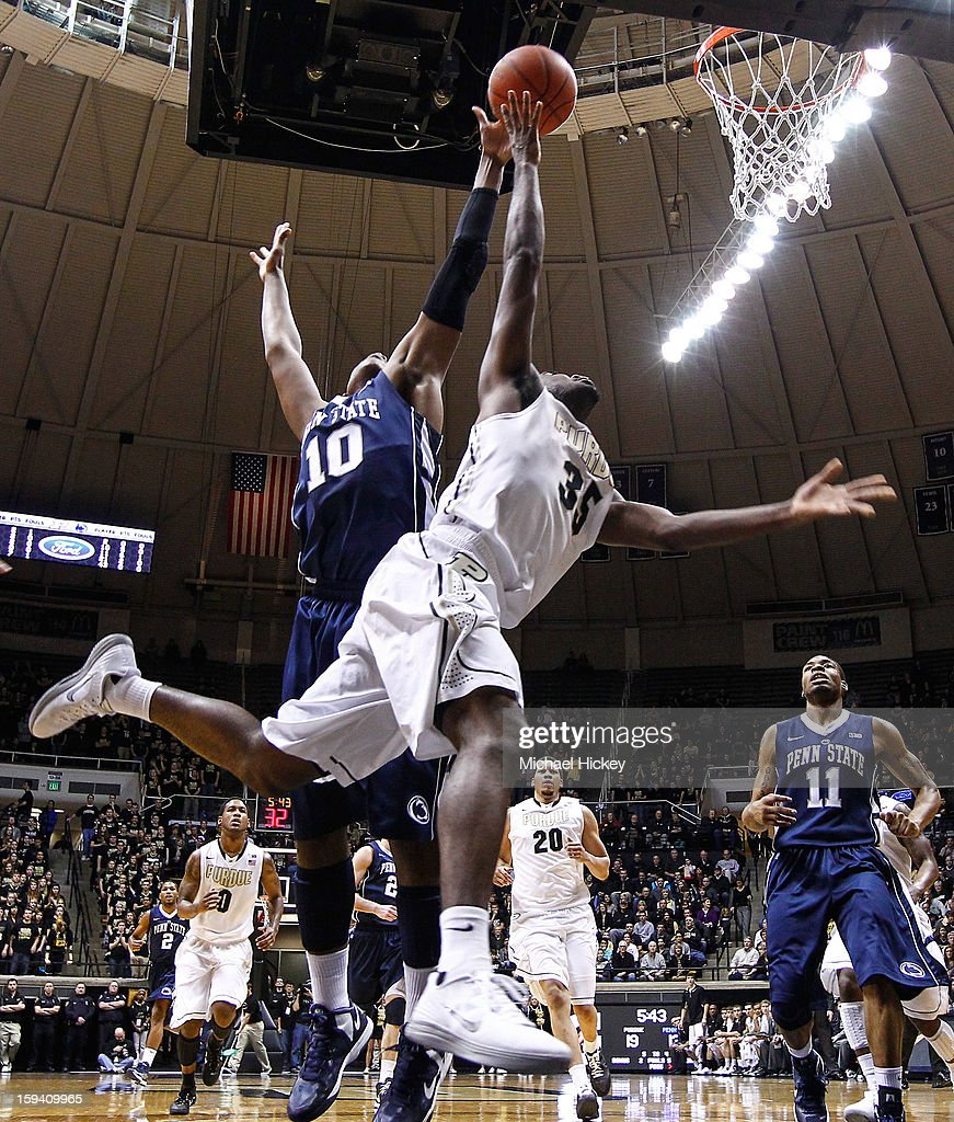Rapheal Davis #35 of the Purdue Boilermakers shoots the ball as Brandon Taylor #10 of the Penn State Nittany Lions defends at Mackey Arena on January 13, 2013 in West Lafayette, Indiana.