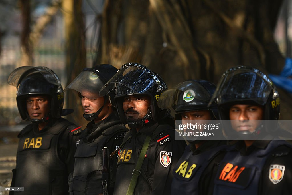 Rapid Action Battalion (RAB) personnel keep watch outside the International Crimes Tribunal court premises during a nationwide strike in Dhaka on February 5, 2013. A Bangladeshi court sentenced a senior Islamist opposition official to life in prison Tuesday for mass murder and crimes against humanity during the 1971 liberation war against Pakistan. AFP PHOTO/Munir uz ZAMAN