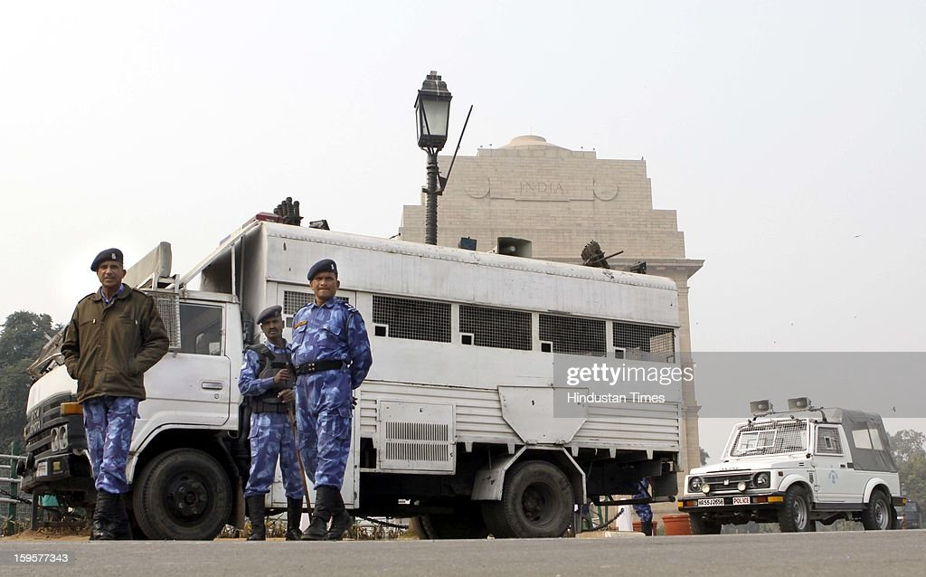 Rapid Action Force jawans are alert at India Gate in wake of Republic Day rehearsals and completion of one month of the gang rape of a 23-year woman in a moving private bus, on January 16, 2013 in New Delhi, India.