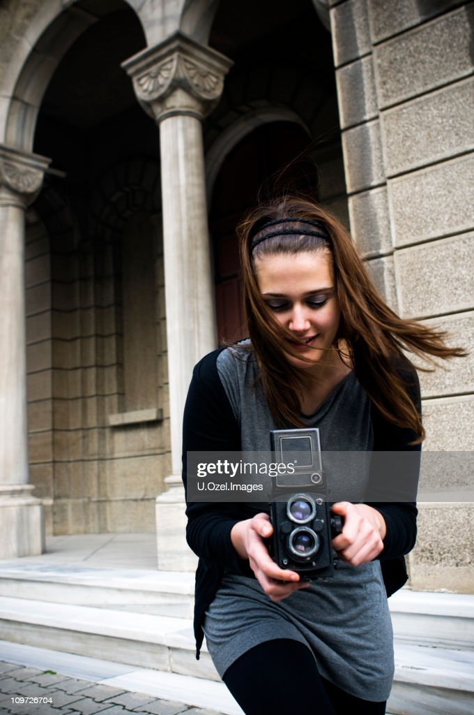 Rapid Photographer with an old camera... : Stock Photo