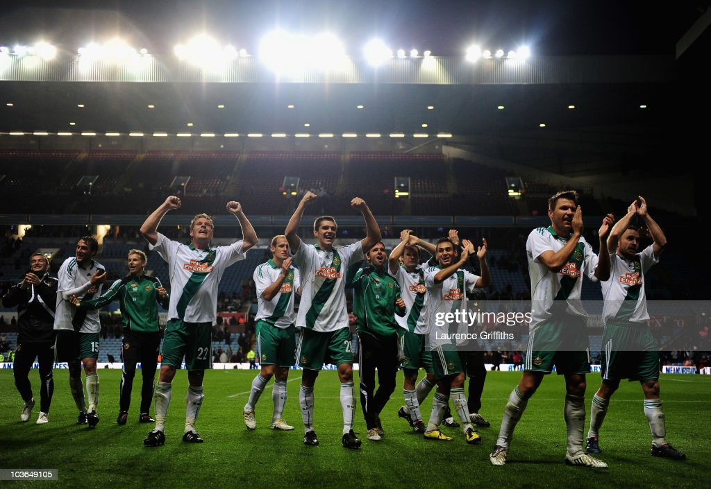 SK Rapid Vienna celebrate on the final whistle during the UEFA Europa League second leg match between Aston Villa and SK Rapid Vienna at Villa Park on August 26, 2010 in Birmingham, England.