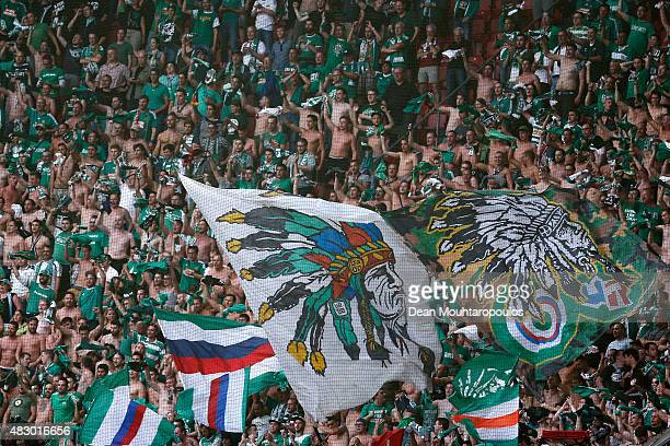 Rapid Wien fans celebrate during the third qualifying round 2nd leg UEFA Champions League match between Ajax Amsterdam and SK Rapid Vienna held at...