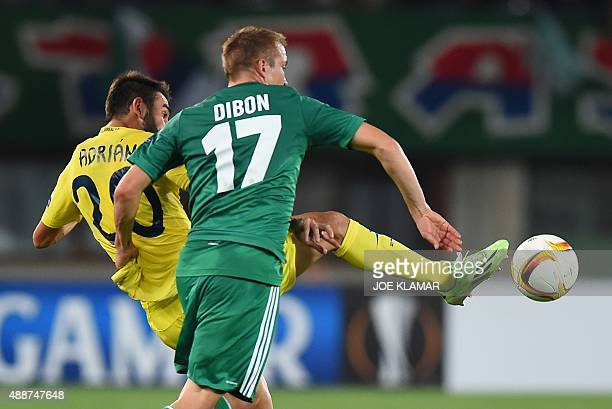 Rapid Wien's Christoppher Dibon and Villarreal's Adrian Lopez vie for a ball during the UEFA Europa League Group E football match between SK Rapid...