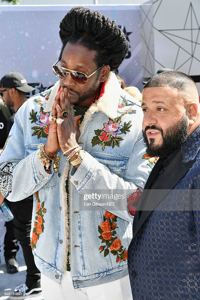 Rapper <a gi-track='captionPersonalityLinkClicked' href=/galleries/search?phrase=2+Chainz&family=editorial&specificpeople=8559144 ng-click='$event.stopPropagation()'>2 Chainz</a> (L) and <a gi-track='captionPersonalityLinkClicked' href=/galleries/search?phrase=DJ+Khaled&family=editorial&specificpeople=577862 ng-click='$event.stopPropagation()'>DJ Khaled</a> attend the Cover Girl glam stage during the 2016 BET Awards at the Microsoft Theater on June 26, 2016 in Los Angeles, California.