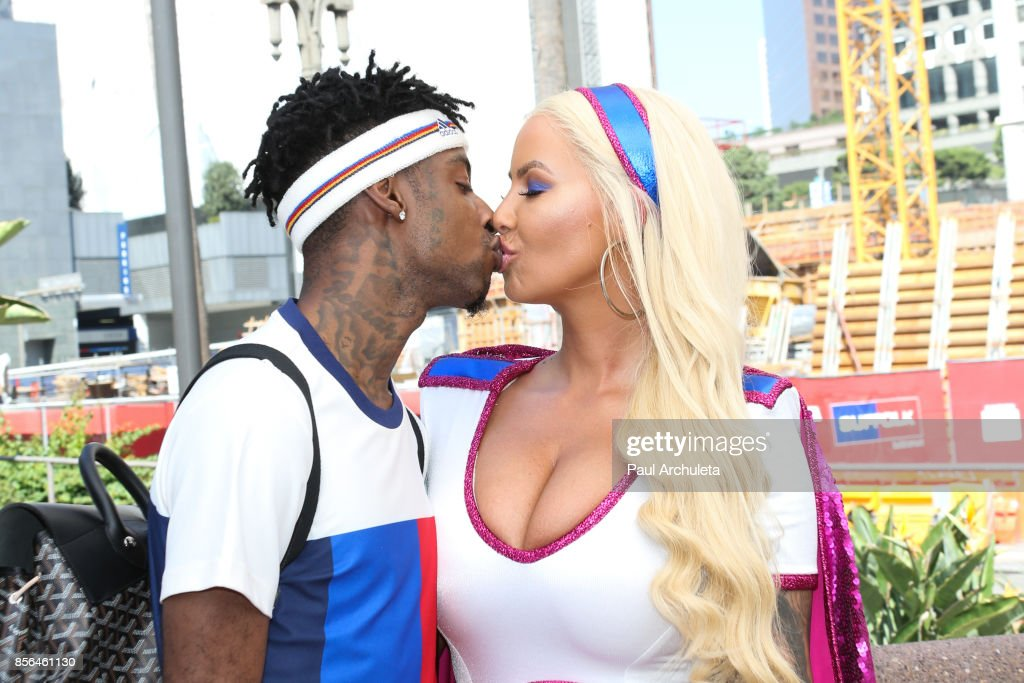 Rapper 21 Savage (L) and Reality TV Personality / Model Amber Rose (R) attend the 3rd annual Amber Rose SlutWalk on October 1, 2017 in Los Angeles, California.