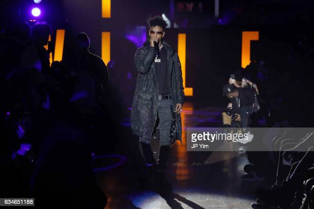 Rapper 21 Savage performs at the VFILES runway show during New York Fashion Week at 1515 Broadway on February 10 2017 in New York City