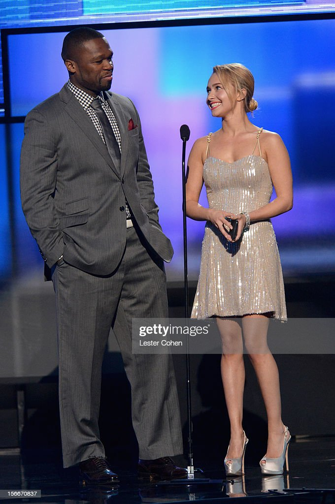 Rapper 50 Cent aka Curtis Jackson (L) and actress Hayden Panettiere speak onstage during the 40th Anniversary American Music Awards held at Nokia Theatre L.A. Live on November 18, 2012 in Los Angeles, California.