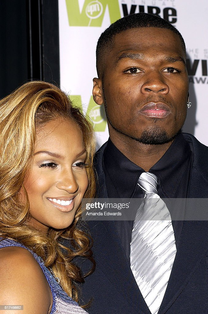 Rapper 50 Cent and singer <a gi-track='captionPersonalityLinkClicked' href=/galleries/search?phrase=Olivia+-+Singer&family=editorial&specificpeople=4525542 ng-click='$event.stopPropagation()'>Olivia</a> attend the 2004 Vibe Awards at Barker Hangar November 15, 2004 in Santa Monica, California.