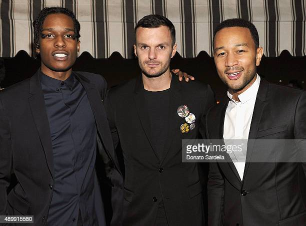Rapper A$AP Rocky Artistic Director Dior Homme Kris Van Assche and singer/songwriter John Legend attend a cocktail event hosted by Dior Homme's Kris...