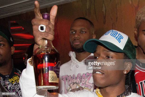 Rapper A$AP Rocky raises a bottle of Courvoisier Cognac during the official afterparty hosted by Courvoisier¨ Cognac on October 2017 in Chicago...