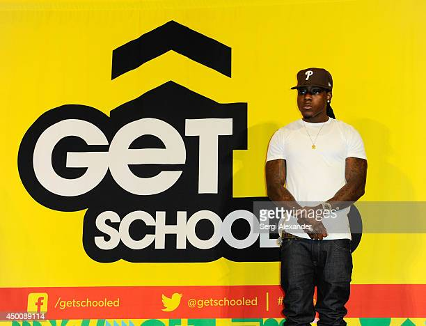 Rapper Ace Hood seen as rapper Flo Rida joins Get Schooled Foundation as celebrity principal for a day at Miami Edison Middle School on June 4 2014...