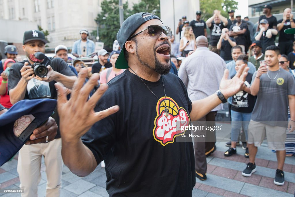 Rapper and actor Ice Cube celebrates after sinking a 4 point shot while promoting BIG3 professional 3 on 3 basketball at Westlake Center on August 18, 2017 in Seattle, Washington.