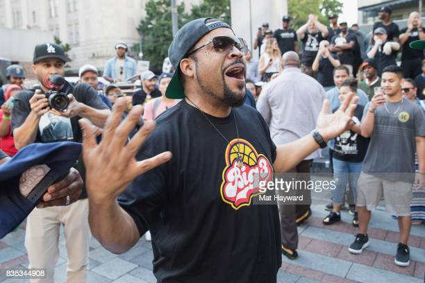 Rapper and actor Ice Cube celebrates after sinking a 4 point shot while promoting BIG3 professional 3 on 3 basketball at Westlake Center on August 18...